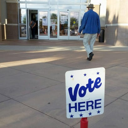 """A """"Vote Here"""" sign outside of the Doña Ana County Government"""