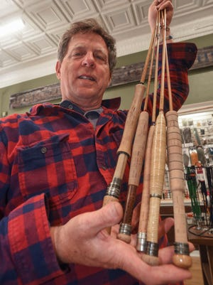 In this June 25, 2017 photo, Steve Sobieniak displays bamboo fly rods at Root River Rod Co. in Lanesboro, Minn. Steve Sobieniak hopes that decades from now, someone will pick up a fly rod he made, cast it, admire how it wafts out line in gentle curls and appreciate its lithe grace and bamboo beauty. It's a passion he brought to the area when he opened Root River Rod Co. May 1 in downtown Lanesboro.
