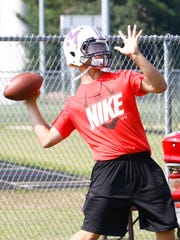 Quarterback Ben Vandehey aims for a throw during practice Tuesday, August 2, 2016 at Mosinee High School football field.