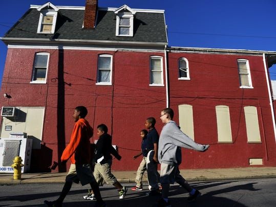 Students walked around the Lincoln Charter School neighborhood last year on Walk to School Day. (File photo)