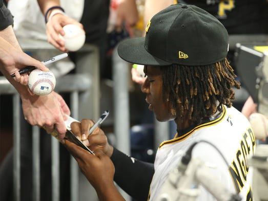 Pirates second baseman Gift Ngoepe signs autographs