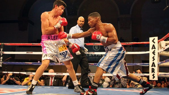 Yuriorkis Gamboa punches during a 2011 bout.