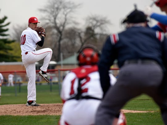 Big Reds' Brett Wagner readies for a pitch Monday, April 17, during boys baseball action against St. Clair at Port Huron High School.