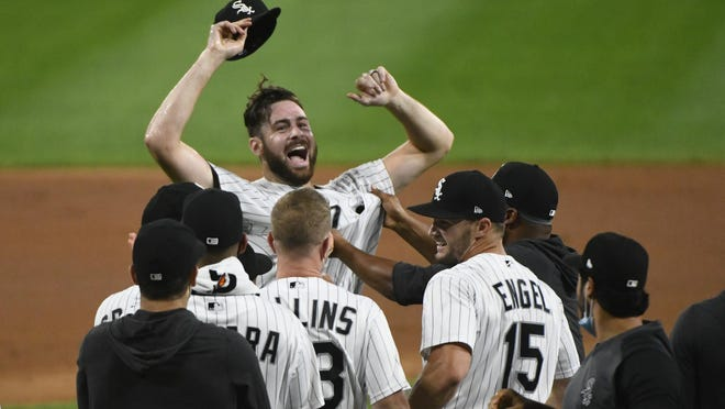 Chicago White Sox starting pitcher Lucas Giolito, facing camera, and teammates celebrate his no-hitter in a baseball game against the Pittsburgh Pirates, Tuesday, Aug. 25, 2020, in Chicago.