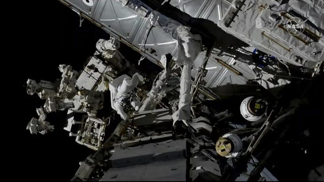 Canadian astronaut David Saint-Jacques, center left, works outside the International Space Station, Monday, April 8, 2019. Saint-Jacques and NASA astronaut Anne McClain got an early start Monday morning as they tackled battery and cable work outside the International Space Station.