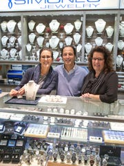 Simone's Jewelry Owner Brian McLean with his store managers Lisa Maleh (left) and Debbie Lagrutta.