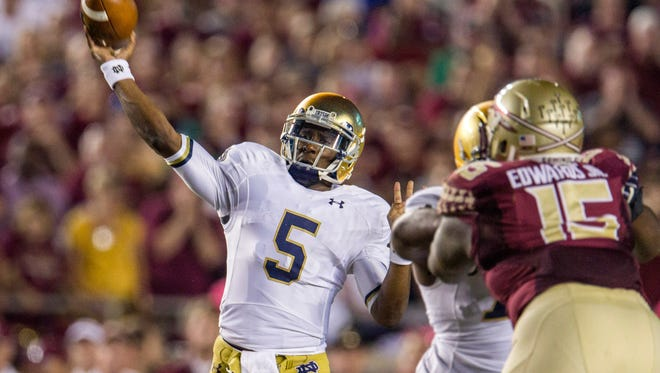 Notre Dame quarterback Everett Golson throws in the first half of an NCAA college football game against Florida State in Tallahassee, Fla., Saturday, Oct. 18, 2014.