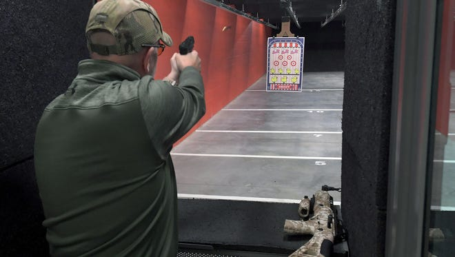 David Coker shoots on the range at Shoot Point Blank in Farragut off Outlet Drive Friday, Jan. 12, 2018.