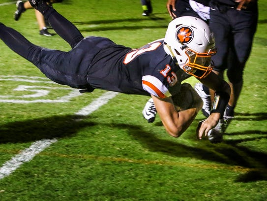 MTCS QB Jackson Green dives into the end zone to score