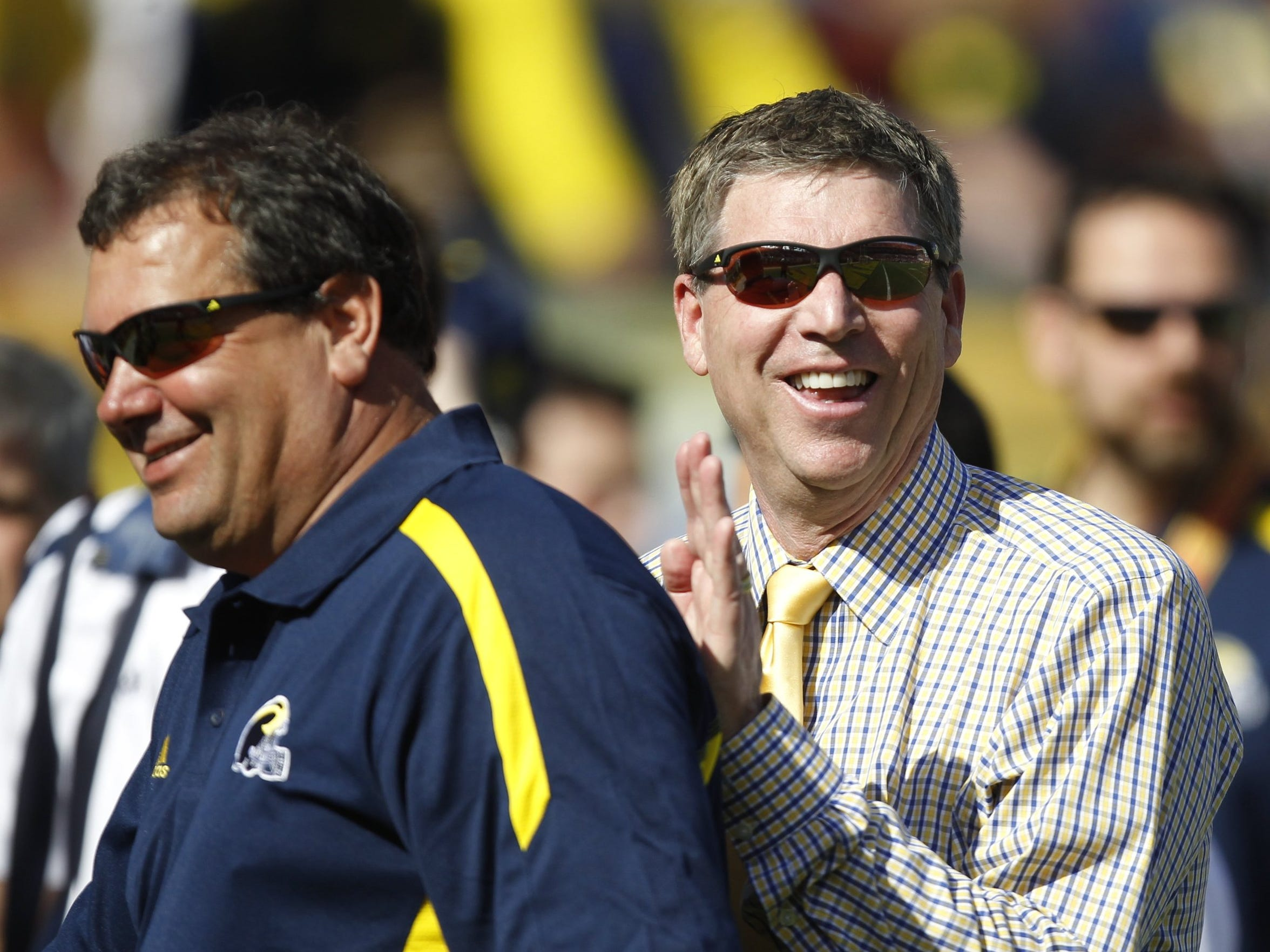 Dave Brandon, right, hired Brady Hoke in January 2011. Nearly four years later, both are out at Michigan.