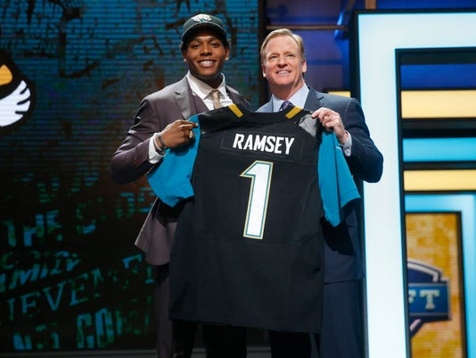 Florida State's Jalen Ramsey poses for photos with NFL commissioner Roger Goodell after being selected by Jacksonville Jaguars as fifth pick in the first round of the 2016 NFL football draft, Thursday, April 28, 2016, in Chicago. (AP Photo/Charles Rex Arbogast)