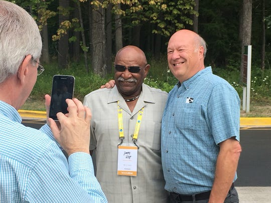 "Jimmy Raye (left) a star QB at MSU in the mid-'60s, meets with fans before the world premiere of the documentary ""Men of Sparta"" at the Traverse City Film Festival on July 31, 2016."