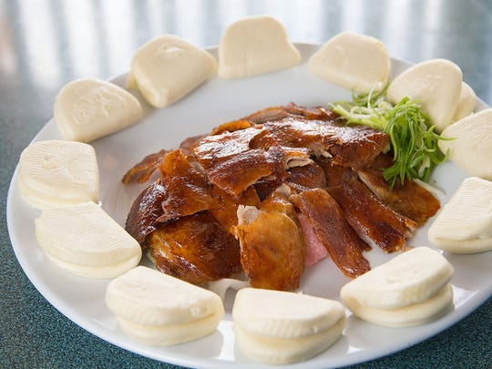 The Peking duck is served in two stages, the first
