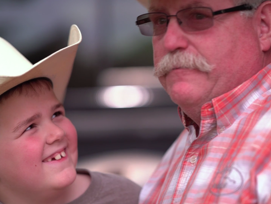 Cayden Holmes and his grandfather, Dan, share a love