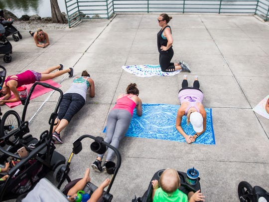 """Jennifer Garner, center, helps lead a group in planks during a """"Stroller Moms"""" workout at Vineyards Park on Tuesday, May 22, 2018."""