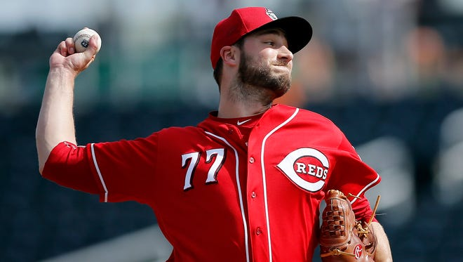 Cincinnati Reds relief pitcher Tim Adleman (77) delivers a pitch in the top of the fifth inning of the MLB Spring Training game between the Cincinnati Reds and the San Francisco Giants at Goodyear Ballpark in Goodyear, Ariz., on Friday, March 4, 2016.  The Reds suffered their first loss of the preseason, 4-3.