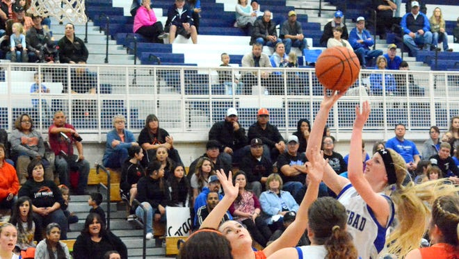 Carlsbad freshman guard Carsyn Boswell makes a layup in the second quarter Friday against Artesia.