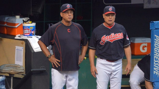 Cleveland Indians manager Terry Francona (17) and bench coach Brad Mills (2) watch from the dugout during a game against the Los Angeles Angels at Progressive Field. The Colorado Rockies should consider Mills as their next manager, columnist Mark Knudson said.