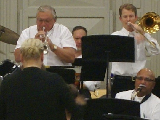Members of the Washington City Community Band during a rehearsal.
