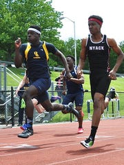 Jaheim Jones of Lourdes (l) en route to a split-second win over Nyack's Dante Brown in boys Class B 100 dash.jpg