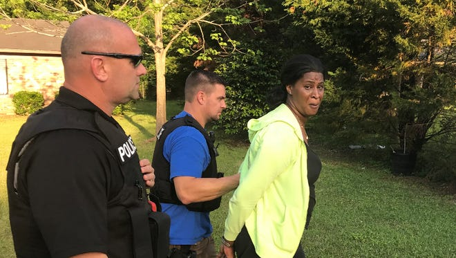 Ebony Lambert, 40, was taken into police custody Wednesday, and charged with hindering the investigation into her aunt Deborah McGee's March 25 murder at her Hattiesburg home.