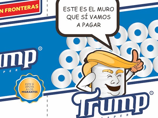 """This illustration released by Antonio Battaglia shows the mock-up design for toilet paper wrapping carrying the Spanish phrases """"Softness without borders,"""" """"This supports migrants,"""" """"Four pure rolls"""" which is a play on words in Spanish that roughly translates as """"Pure nonsense,"""" and """"This is the wall that, yes, we will pay for."""""""