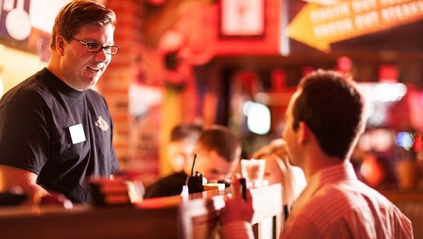 Ware Skyes, the CEO of NoWait, working at a Texas Roadhouse restaurant. All employees of NoWait are required to work two shifts at a restaurant before officially starting at the company.