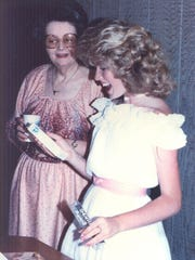 Ruth Johnson, left, looks at her granddaughter, the late Laura Reynolds, during her eighth grade graduation party in 1983 in Tulare. Laura was killed by a drunk driver in 1985.