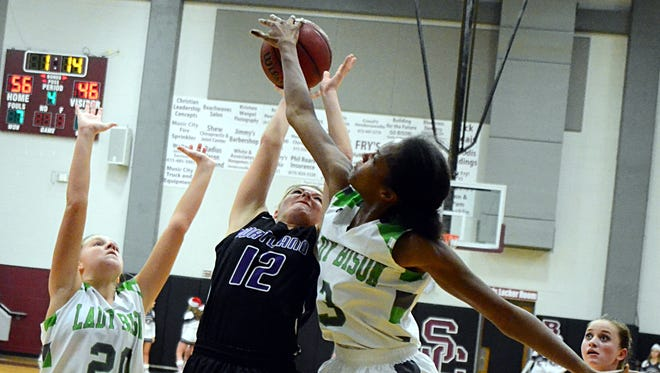 Station Camp High junior Linze Edwards blocks a shot attempt from Portland senior Erica Keen during fourth-quarter action. Edwards blocked 11 shots and scored 18 points in Station Camp's 61-45 victory.