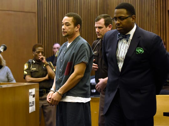 Gregory Green, left, stands during his sentencing in