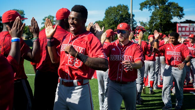 UL outfielder Jam Williams (33), who made his first start of 2017 in centerfield on Tuesday night at Nichols State, high-fives teammates after a 2015 NCAA Regional win over Rice in Houston.