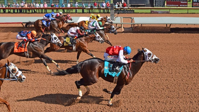 Ec Jet One, ridden by Esgar Ramirez for trainer Judd Kearl, pulls clear of his rivals on Sunday in the $2.4 million All American Derby at Ruidoso Downs Race Track and Casino.