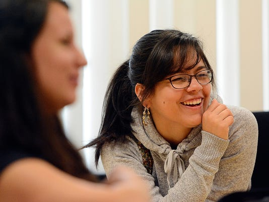Tania Collazo laughs recently at William Penn High School. Collazo and her classmates have overcome a lot of hurdles during their time at York High.