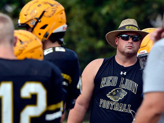 Red Lion head coach Jesse Shay leads his team in practice on Wednesday. Shay will lead the Lions in their home opener at 7 p.m. Friday vs. Manheim Township at Horn Field. Before the game, a moment of silence will he held to honor the memory of two former Red Lion players, who died in a car accident in June.