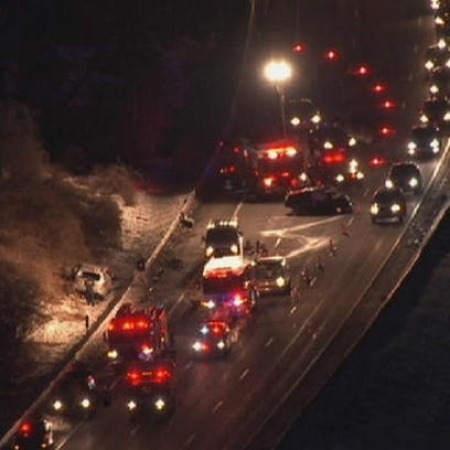 Police investigate a fatal two-car accident on the