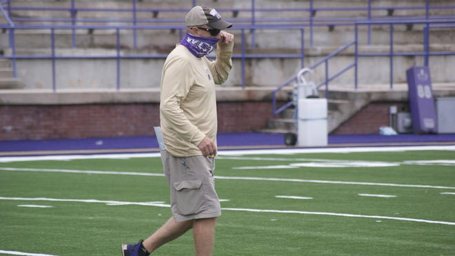 Western Carolina head football coach Mark Speir walks off the field after a practice held earlier this year in Cullowhee.