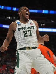 Michigan State forward Xavier Tillman celebrates after scoring against Bucknell during the first half of the NCAA tournament Friday, March 16, 2018 at Little Caesars Arena.