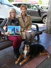 Kayla Van Lydegraf, left, vice president of Dale's Remodeling, Susan Carey, development director for the Willamette Humane Society and Susan's dog Lizzy, are promoting an auction of a She Shed Dream Shed.