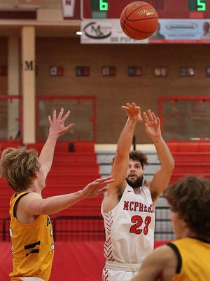 McPherson's Sam Elliott (23) shoots a three point basket past Newton's Dylan Petz (2) during their game Tuesday night. McPherson defeated Newton 75-61.
