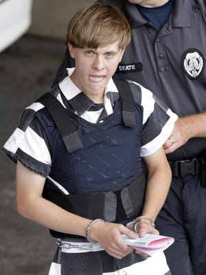 Charleston shooting suspect Dylann Storm Roof is escorted from the Cleveland County Courthouse in Shelby, North Carolina, Thursday, June 18, 2015. Roof is a suspect in the shooting of several people Wednesday night at the historic The Emanuel African Methodist Episcopal Church in Charleston.