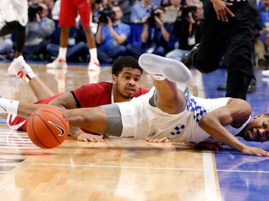 Kentucky's Malik Monk, right, and Arkansas' Anton Beard dive for the ball during the second half of an NCAA college basketball game, Saturday, Jan. 7, 2017, in Lexington, Ky. (AP Photo/James Crisp)