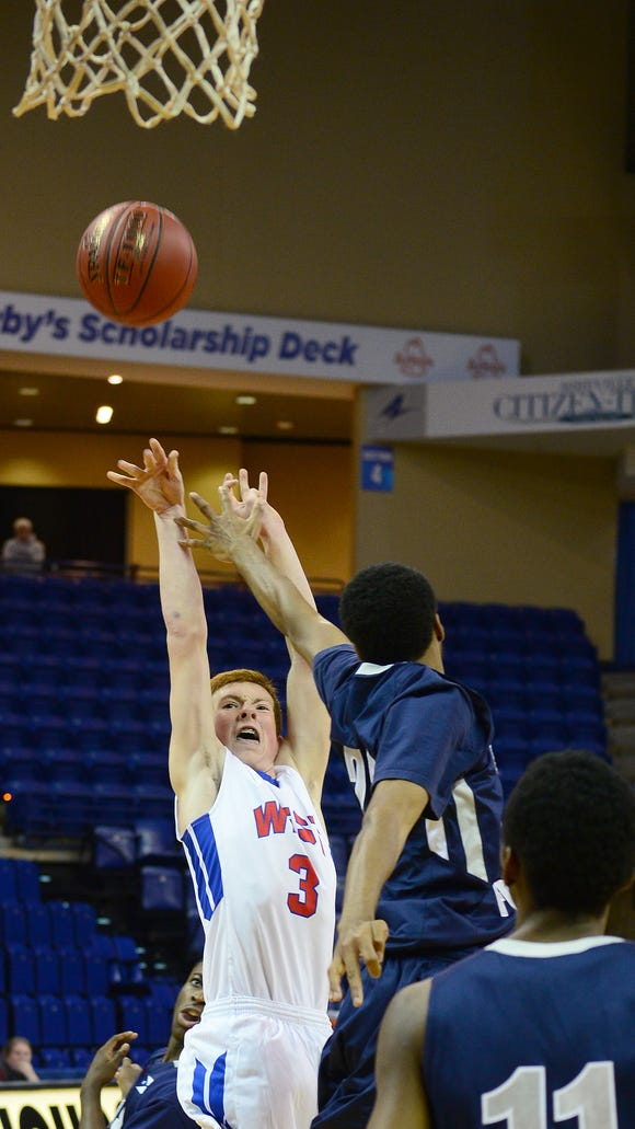 West Henderson's Ben Bryson goes up for a shot against East Forsyth's Josh Wiley during their game in the Coaches vs. Cancer Shootout at Kimmel Arena at UNC Asheville on Saturday, Nov. 26, 2016.