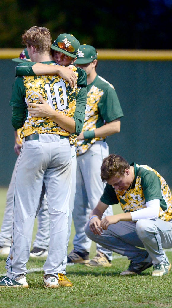 Reynolds' Josh Dotson and Jimmy Baumstark comfort one