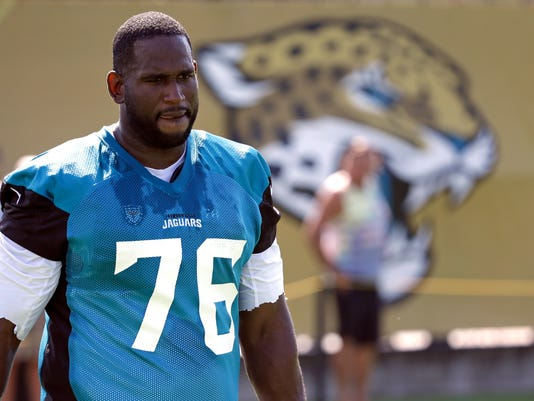 FILE - In this July 28, 2017, file photo, Jacksonville Jaguars offensive lineman Branden Albert (76) arrives at practice during NFL football training camp, in Jacksonville, Fla. Branden Albert has abruptly retired. The two-time Pro Bowl selection was acquired in a trade with the Miami Dolphins in March. He called it quits at age 32 Monday, July 31, 2017, after three days of training camp and nine NFL seasons. (AP Photo/John Raoux, File)