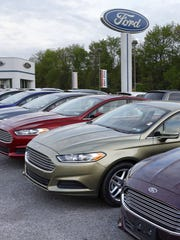 Cars are seen at an automobile dealer in Zelienople,