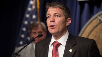 Rep. Ed Henry, R-Hartselle, announces that he will be filing for Governor Robert Bentley's impeachment before filing it in the Alabama House of Representatives on Tuesday, April 5, 2016, at the Alabama State House in Montgomery, Ala.