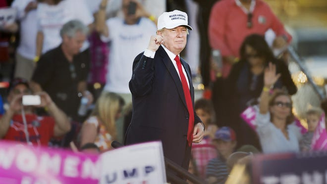 Republican presidential nominee Donald Trump addresses thousands Sunday at a rally at the Collier County Fairgrounds.