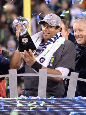 Russell Wilson celebrates the Seahawks' first Super Bowl title.