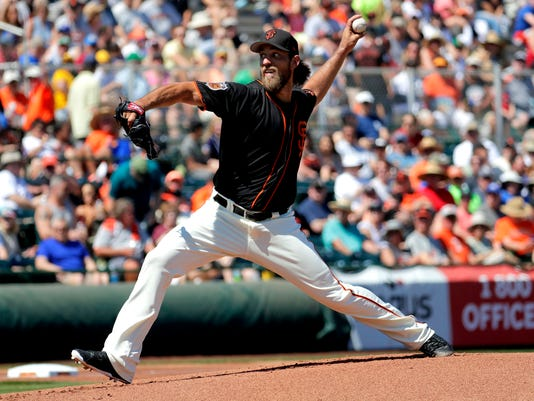 San Francisco Giants starting pitcher Madison Bumgarner throws against the San Diego Padres during the first inning of a spring training baseball game, Tuesday, March 21, 2017, in Scottsdale, Ariz. (AP Photo/Matt York)