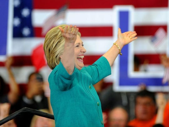 "JUAN CARLO/THE STAR Democratic presidential candidate Hillary Clinton fires up the crowd during her rally Saturday at Hueneme High School in Oxnard. The ""Get Out the Vote"" event took place in the school's gym."